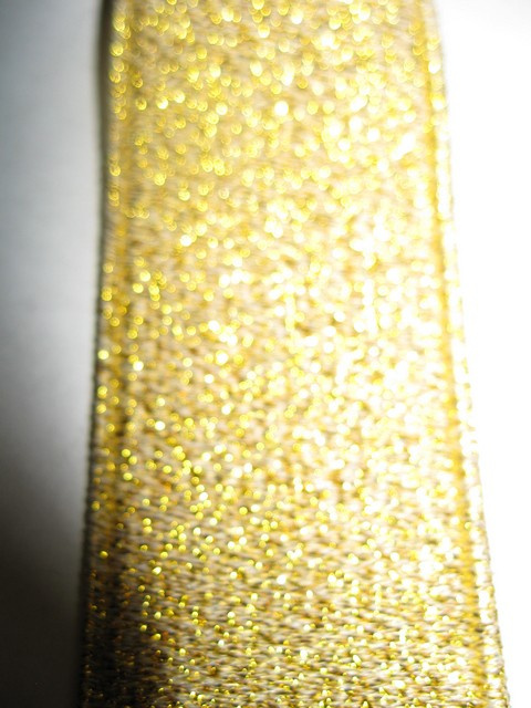 "GOLD GLITTER ""X"" STYLE  1 1/4""X48"" FRENCH SATIN FINISH Suspenders with 4 strong 1/2""x 1"" Grips with nylon Teeth and 2 adjusters in the front and 1 on the back all in high polish GOLD FINISH.    GF760N48GOLD"